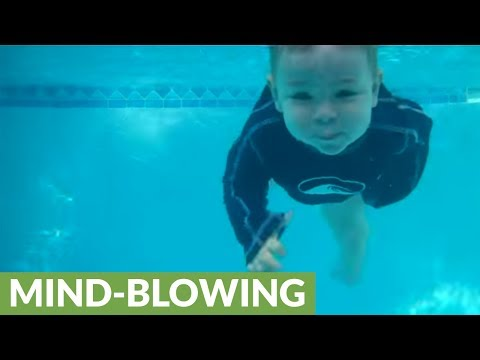 Talented baby jumps in and swims across pool