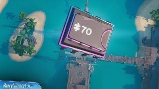 Fortbyte #70: Accessible by Skydiving Through Rings Above Lazy Lagoon with Vibrant Contrails