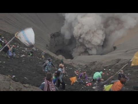 Life goes on inside Bali's Mt Agung volcano danger zone
