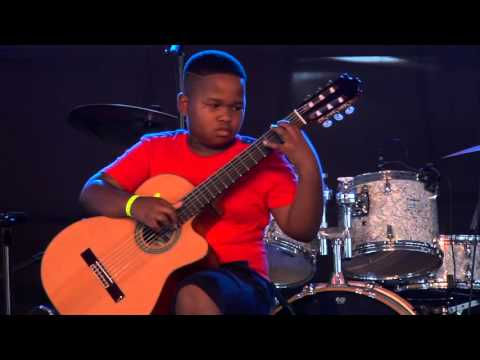 10 year old guitarist performs at Jacob G Zuma RDP Education Trust Christmas Party