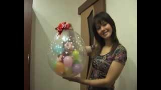 Упаковка подарка в шар.mp4(Конкурсная работа Елены Рубачевой. В этом уроке она показывает как упаковать подарок в шар. http://aerodesigne.ru., 2012-02-29T08:00:05.000Z)