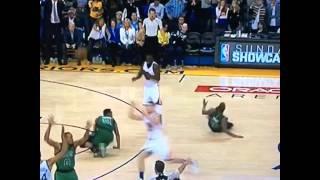 Warriors' Draymond Green tackles Celtics' Marcus Smart & Evan Turner to get himself open.