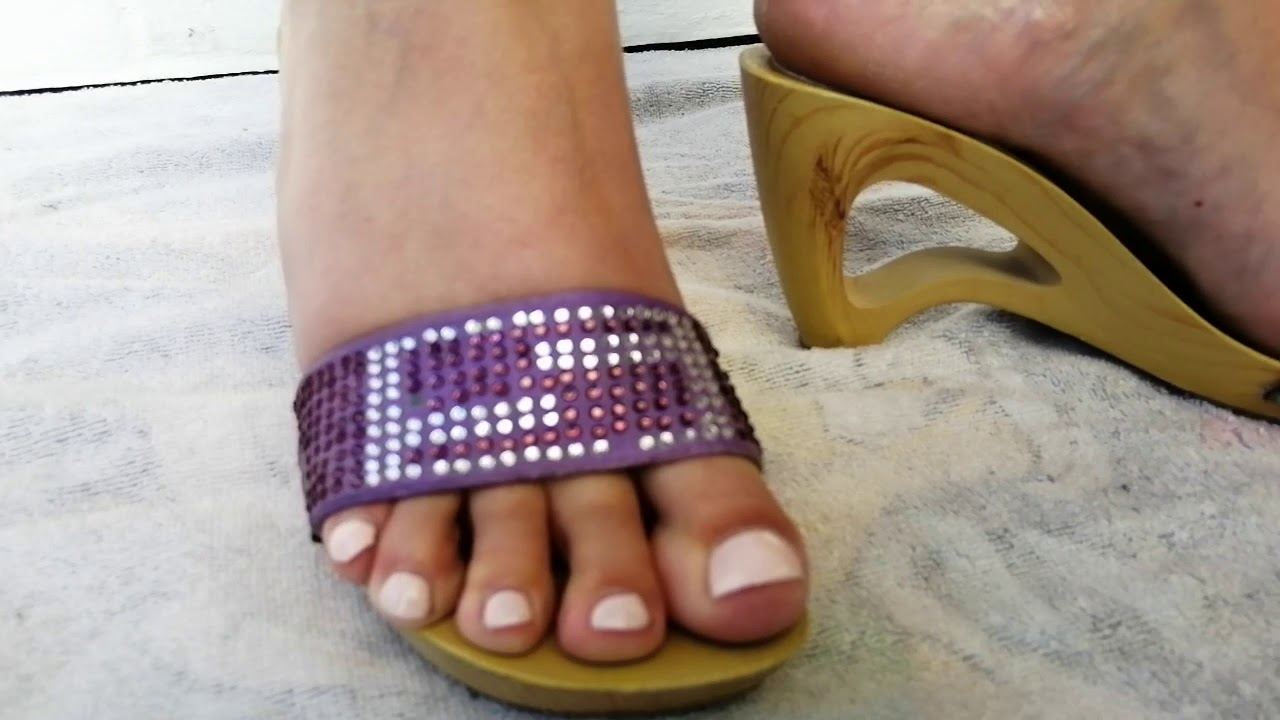 Mature feet in wooden mules shoeplay