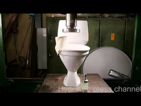Crushing toilet seat with hydraulic press