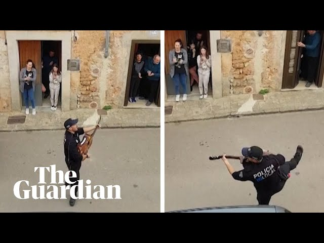 Spanish police sing to families during coronavirus lockdown in Mallorca