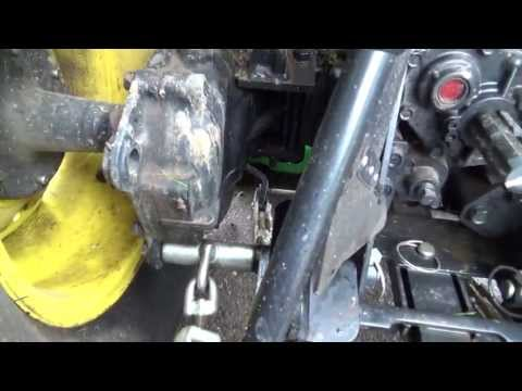 broken mower bracket and Agri-fab sweeper assembly