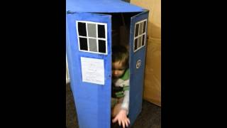 Homemade tardis police box doctor who - Child playing inside painted up cardboard box