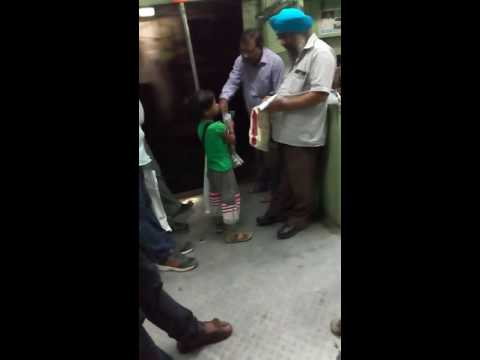 The Little Girl selling a pen in Mumbai local