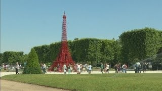 Eiffel Tower recreated with red chairs in 125th birthday tribute