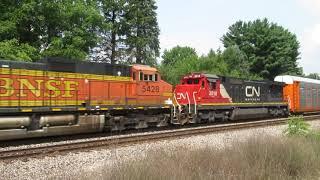 CREX 1505, CN 2843, BNSF 5428, CN 2018 pull auto rack, hopper freight train Westbound in Michigan