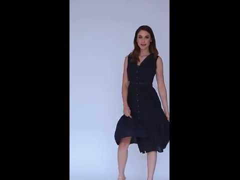 Video: Modna sukienka midi z haftu z dekoltem na napy