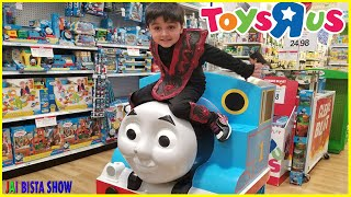 kid driving parents car to toys r us toys hunt at toys r us before store closing forever