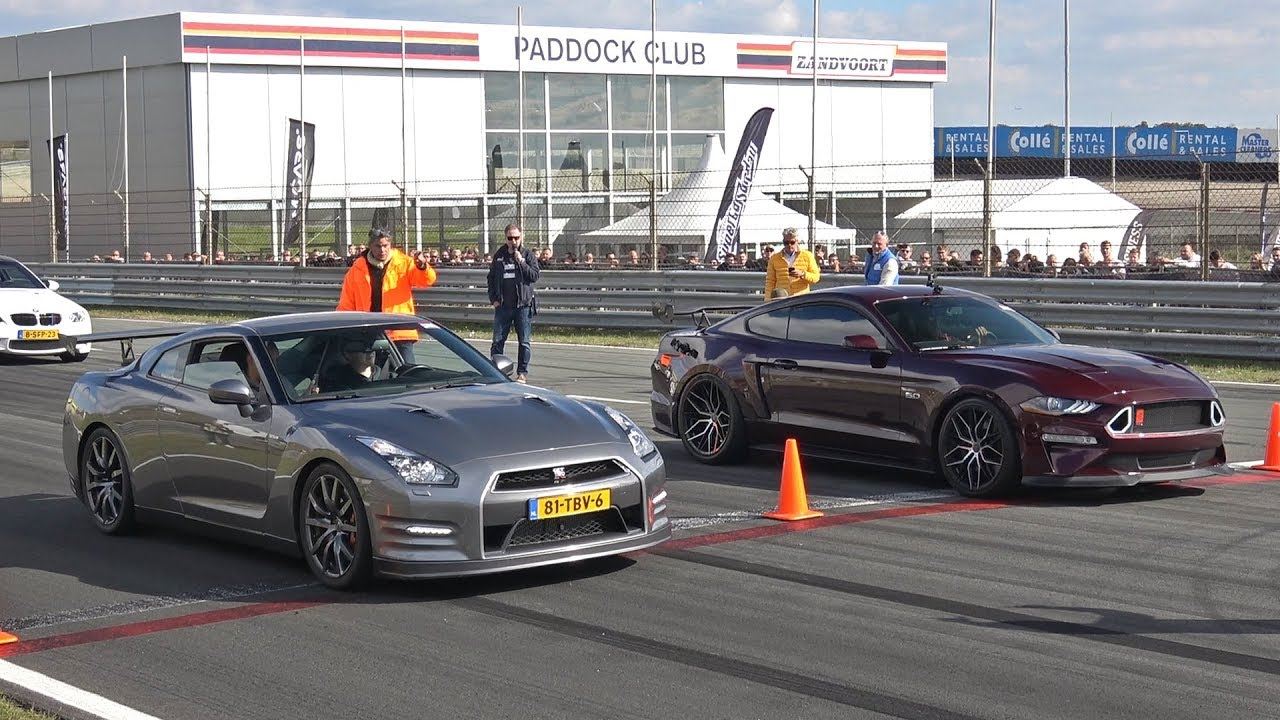 Ford mustang 5 0 v8 royal crimson gt performance vs nissan gt r