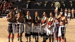 Angami Nagas playing Tati  musical instrument in groups