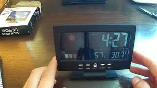 Цифрові , настільний годинник-будильник з термометром і метеостанцією на борту з Китаю model 8082t