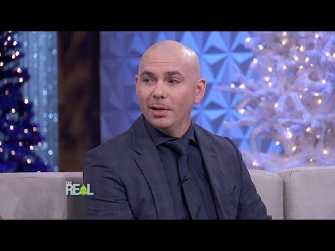 Pitbull Loves Strong Women, Pantsuits, and Making Education Sexy!