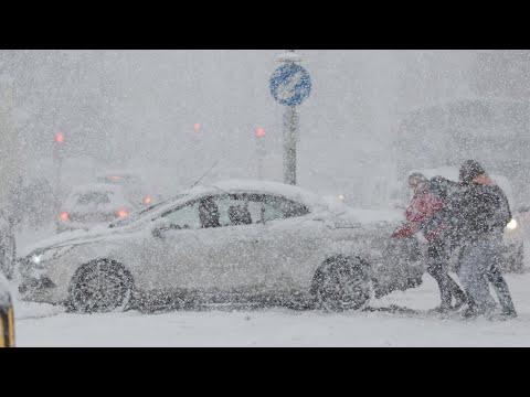 Snowy scenes across UK as 'beast from east' hits
