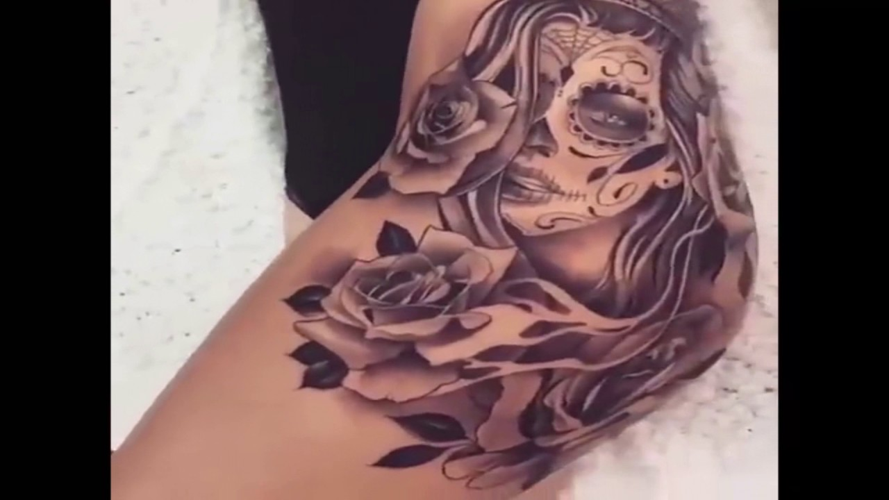 Beautiful black tattoo on a woman 39 s hip youtube for Minimize tattoo pain