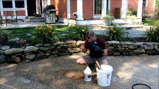 Muriatic acid removing a rust stain from concrete 2