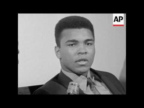"An ungleeful looking Cassius Clay -- ""call me Muhammad Ali"" said he was elated over his 7th round kn"