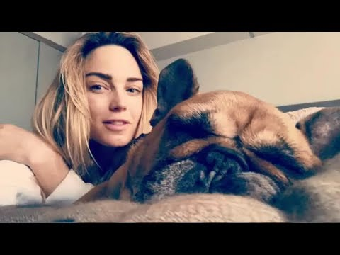 Caity Lotz Playing With Her Dogs