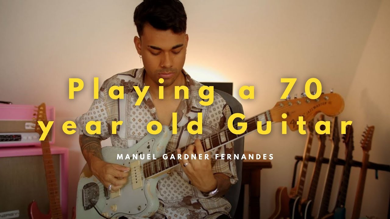 Download Playing a 70 year old Guitar