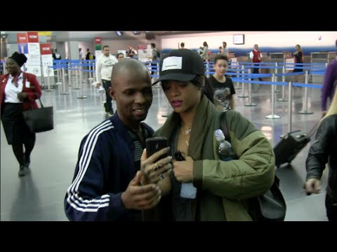 EXCLUSIVE - Rihanna talks about R8 at JFK Airport in NYC 10-01-14