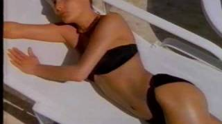 Bain de Soleil ad with black bikini clad girl 1987