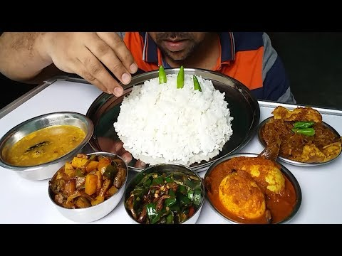 egg curry and omelet curry eating with rice (spicy Bengali food)