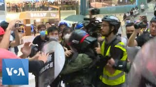 Anti-Government Protesters and Hong Kong Police Clash in Mall