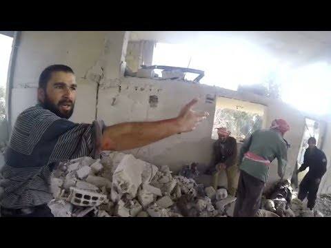 Eastern Ghouta: Children pulled from rubble in White Helmets video