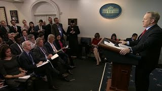 White House vows to appeal ruling blocking travel ban