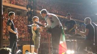 Coldplay And A 9-year-old Boy Perform Don't Panic  With Harmonica