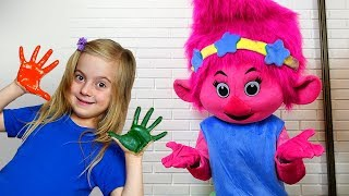 Girl pretend play  with Mommy and Troll