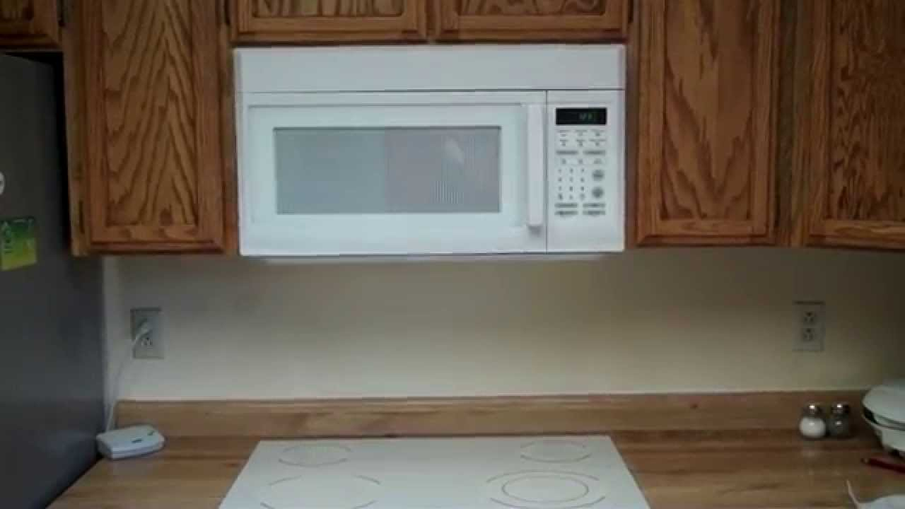 How to Install a Microwave over the stove - YouTube