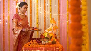 Beautiful Indian woman worshipping Lord Ganesha with pooja ki thali - Festival celebration