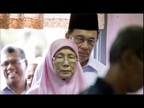 Jailed Malaysian opposition leader's wife wins his seat