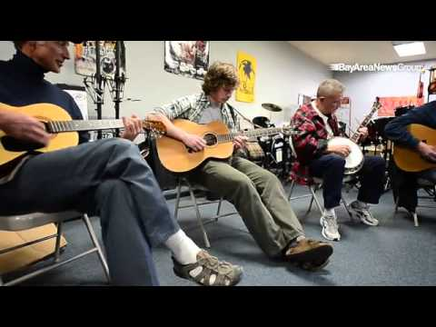 The weekly Wednesday night bluegrass jam in the upstairs practice room at Music Works in El Cerrito,