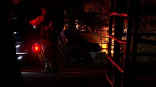 Woman's body found after travel trailer catches fire outside Houston home | Raw scene video