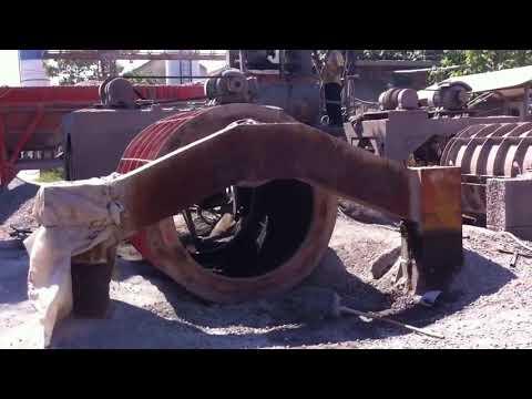 Concrete pipe making machine.