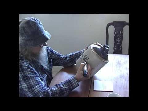 Tommy Hall of The 13th Floor Elevators signing a jug for Kickstarter