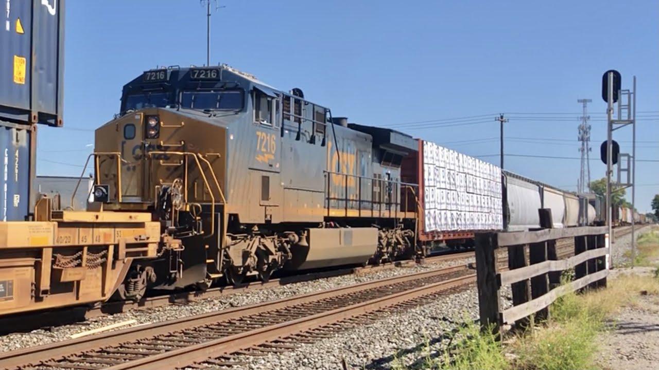 Download 2 Railroad Diamonds At 4 Track RR Crossing & Long CSX Train With DPU Crosses Norfolk Southern Main