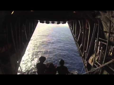 HC-130 Hercules Airplane Crew Drops Equipment to Crew who Abandoned Ship South of Hawaii