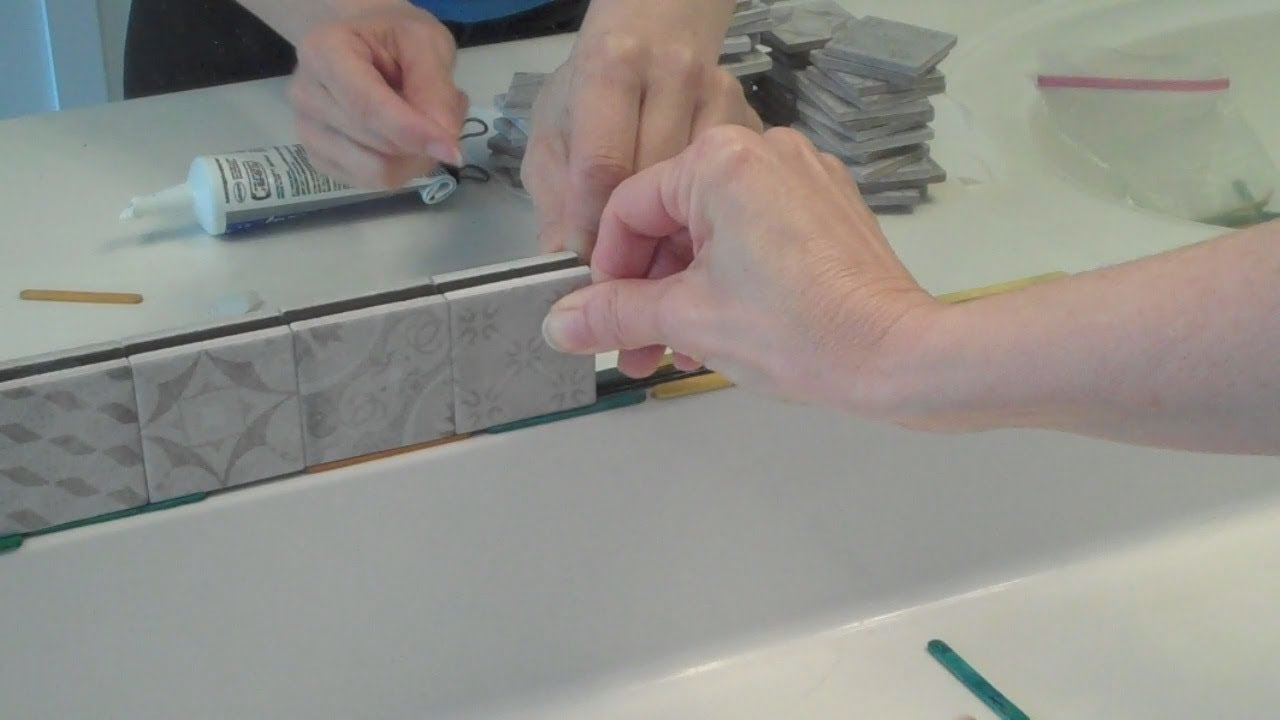 framing a builder grade mirror with tile
