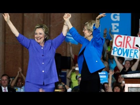 Clinton and Warren embrace to bash Trump