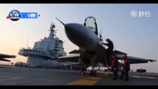 China's Liaoning aircraft carrier conducts fighter drills with J-15 fighter jets in South China Sea