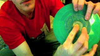 How to remove a metal center from 45 rpm record!