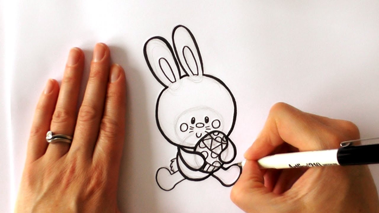 how to draw a cartoon easter bunny holding an easter egg youtube
