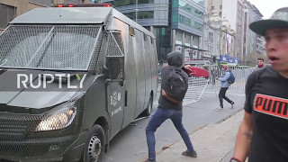 Chile: Students protesting uni debts water cannoned by police in Santiago