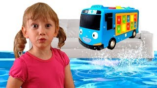 Alena and Pasha play with toy Minibus and save it from water